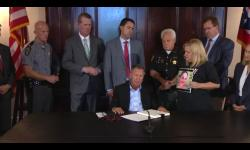 Prosecutor Lutz attending Governor's signing of Senate Bill 1